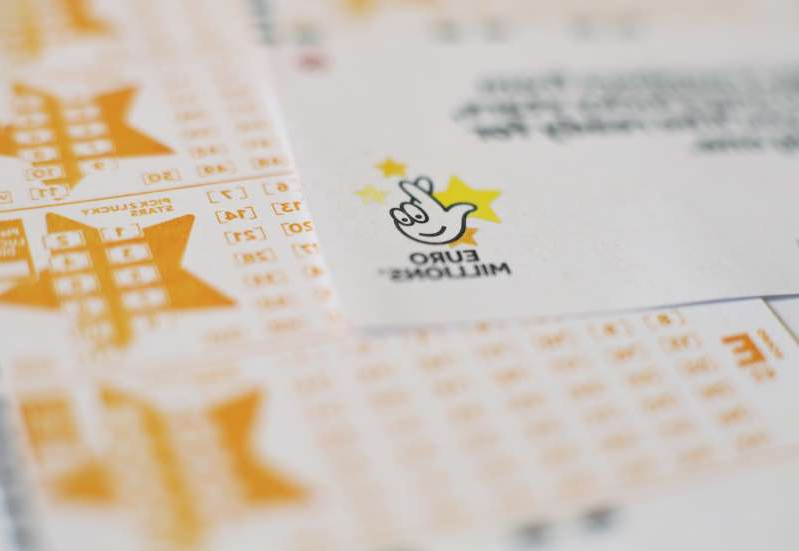 a close up of text on a white surface: A UK ticket-holder has scooped the £40m jackpot (Yui Mok/PA)