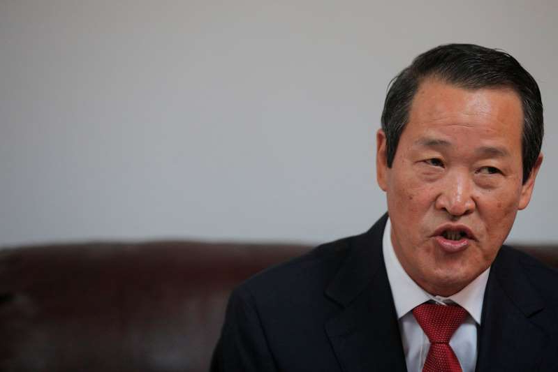 a man wearing a suit and tie: FILE PHOTO: North Korean ambassador to the United Nations Kim Song speaks during a news conference in New York