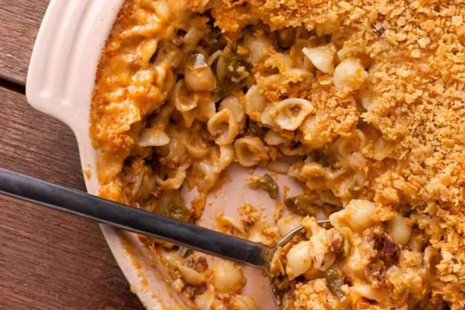 a plate of food with a slice of pizza: Tex Mex mac and cheese recipe