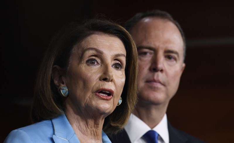 Adam Schiff, Nancy Pelosi are posing for a picture
