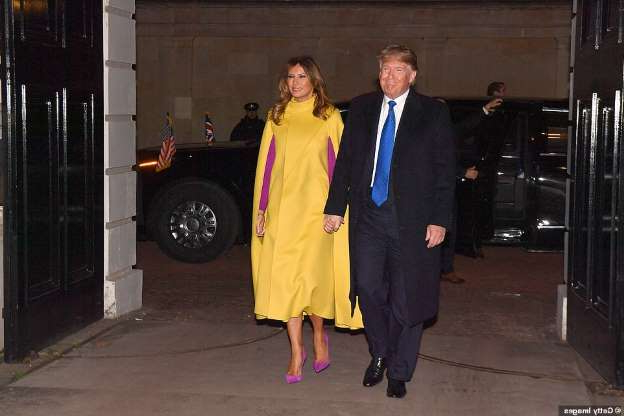 Donald Trump, Melania Trump are posing for a picture: US President Donald Trump and wife Melania arrive at Clarence House to meet Prince Charles, Prince of Wales and Camilla, Duchess of Cornwall before being whisked to Buckingham Palace for a gathering of Nato leaders