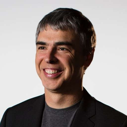 Larry Page wearing a suit and tie smiling at the camera: Larry Page. (Google Photo)