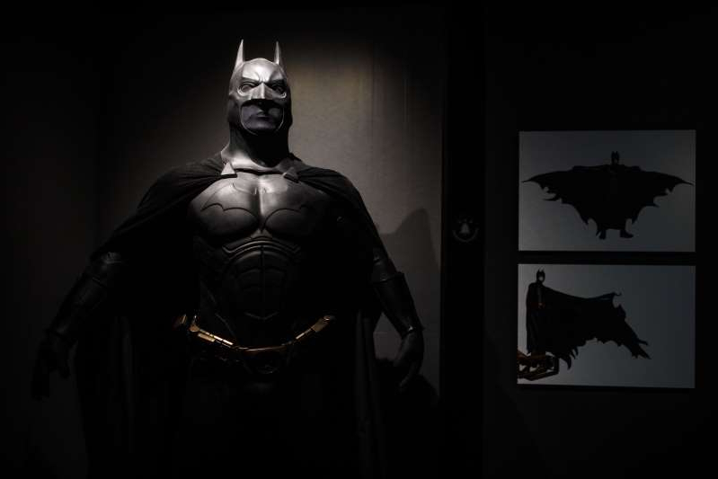 LONDON, ENGLAND - FEBRUARY 22: A Batman costume from the 2005 Batman Begins film worn by Christian Bale and designed by Lindy Hemming is on display at the DC Comics Exhibition: Dawn Of Super Heroes at the O2 Arena on February 22, 2018 in London, England. The exhibition, which opens on February 23rd, features 45 original costumes, models and props used in DC Comics productions including the Batman, Wonder Woman and Superman films. (Photo by Jack Taylor/Getty Images)