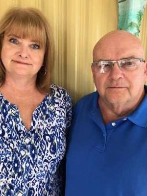 a man and woman posing for a photo: Martha and Dennis Willis winter in Fort Myers, Fla. They're worried their private insurance premiums will increase with the loss of OHIP coverage.
