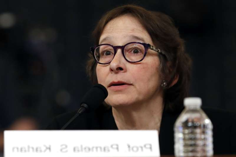 Constitutional law scholar Stanford Law School professor Pamela Karlan apologizes for a remark she made about Barron Trump, President Donald Trump's son, during a hearing before the House Judiciary Committee on the constitutional grounds for the impeachment of President Donald Trump, Wednesday, Dec. 4, 2019, on Capitol Hill in Washington. (AP Photo/Jacquelyn Martin)