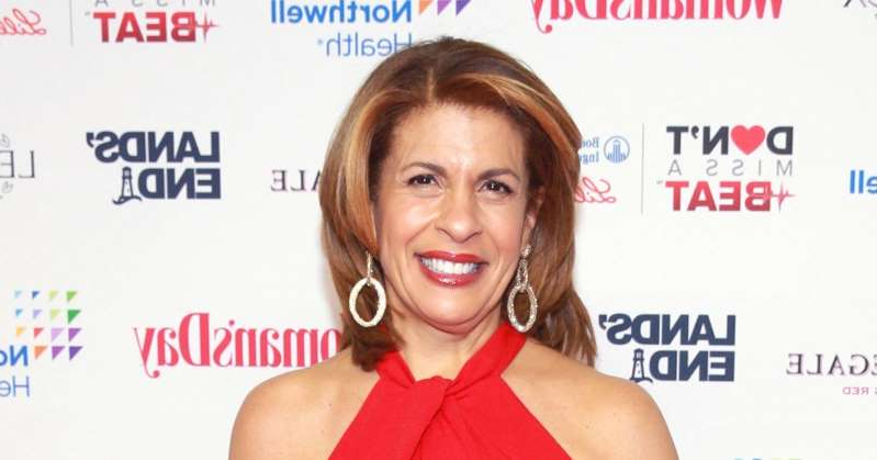 Hoda Kotb holding a sign posing for the camera: Hoda Kotb Will Be 'the Opposite of a Bridezilla' During Wedding Planning: 'I Want Everybody to Feel Easy Breezy'
