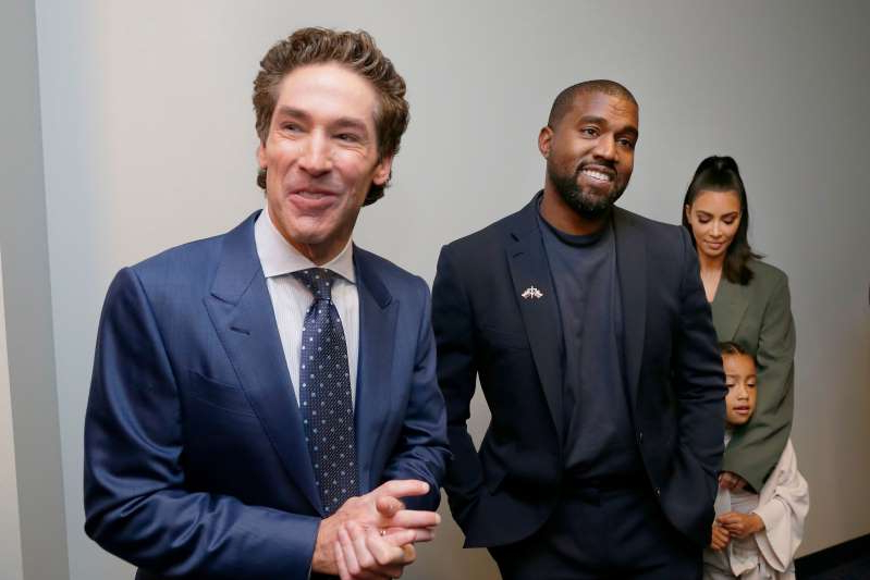 Kim Kardashian, Kanye West, Joel Osteen standing next to a man in a suit and tie: Kim Kardashian West, North West, Kanye West and Sr. Pastor Joel Osteen answer media question after the 11 a.m. service at Lakewood Church in Houston, Texas, on Nov. 17, 2019.