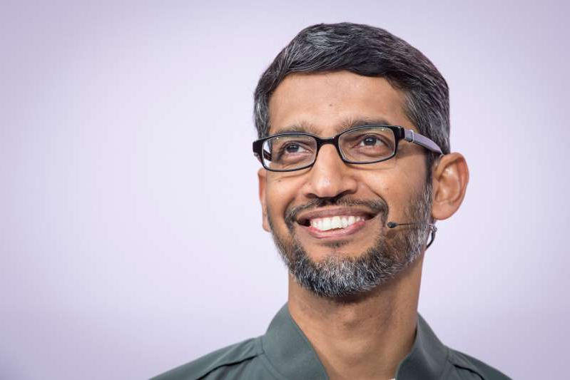 Sundar Pichai wearing glasses and looking at the camera