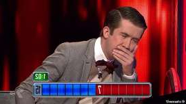 a man sitting in front of a computer: Gaffe: Viewers of Channel Seven quiz show The Chase Australia were left furious after Thursday night's episode was unexpectedly cut short. Pictured: Issa Schultz