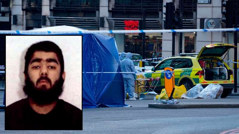 a person standing in front of a building: Usman Khan was one of nine members of a terror group that plotted to bomb the London Stock Exchange