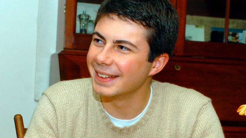 a young boy who is smiling and looking at the camera: Pete Buttigieg in 2004, the year he was awarded a Rhodes scholarship. Two years later, he was vying for a consulting job at McKinsey & Company.
