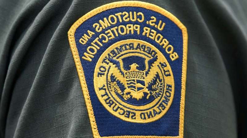 a close up of a logo: A U.S. Customs and Border Protection patch is seen on the arm of a U.S. Border Patrol agent in Mission, Texas, July 1, 2019.
