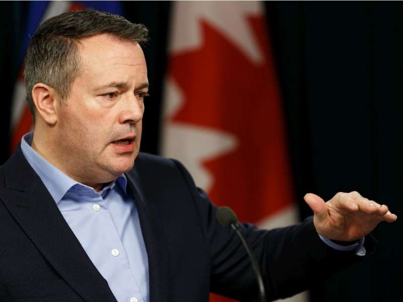 Jason Kenney wearing a suit and tie: Premier Jason Kenney speaks about an upcoming government trip to Ottawa during a press conference at the Alberta Legislature in Edmonton on Friday.
