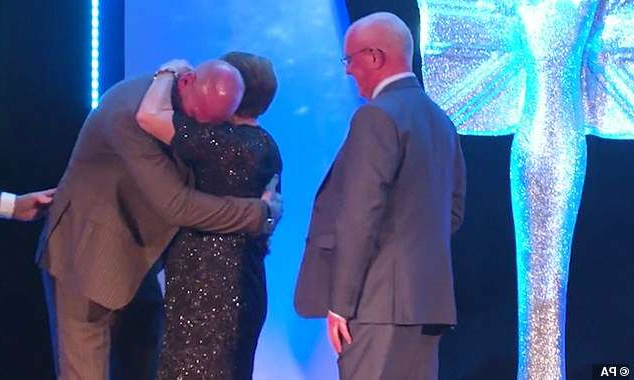 a group of people wearing costumes: Shocked: Thomas wasn't expecting his parents to be at the Mirror Pride of Sports Awards ceremony as he thought they were at home looking after his dog in Wales