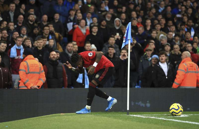 Manchester United's Fred reacts after objects are thrown at him during the English Premier League soccer match at the Etihad Stadium, Manchester, England Saturday Dec. 7, 2019. (Mike Egerton/PA via AP)