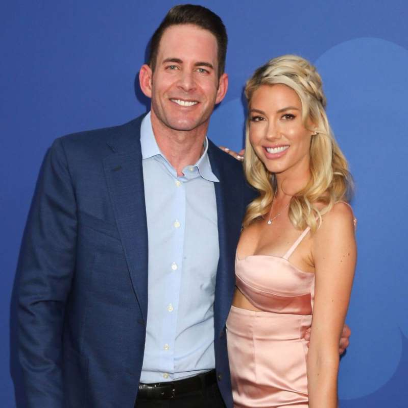 Tarek Moussa et al. posing for the camera: Heather Rae Young and Tarek El Moussa attend 'A Very Brady Renovation' TV show premiere at The Garland in Los Angeles, CA on September 5, 2019.