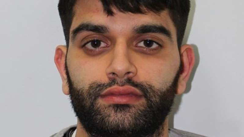 a close up of a man with a beard looking at the camera: Zain Qaiser, 25, is being forced to repay hundreds of thousands of pounds