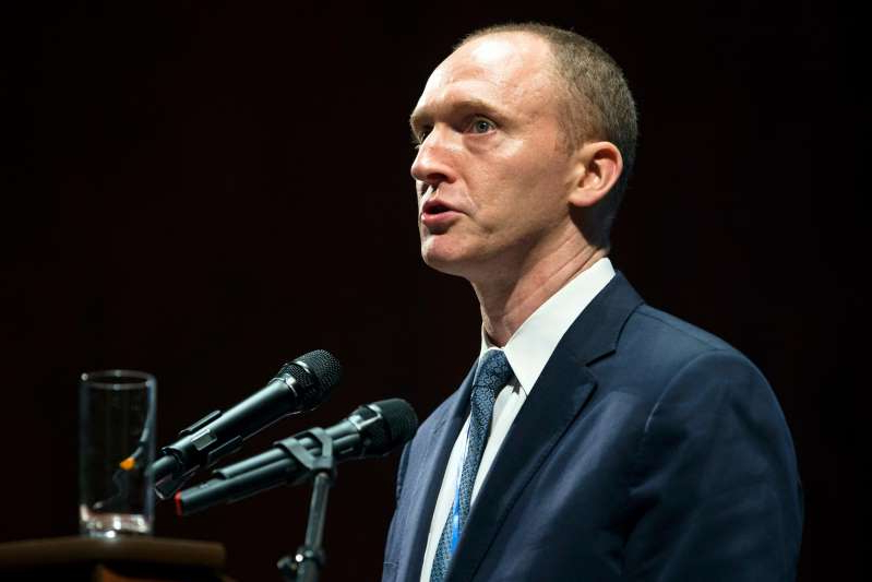a man wearing a suit and tie: Carter Page speaks in Moscow on July 8, 2016.