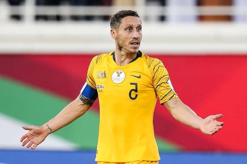 AL AIN, UNITED ARAB EMIRATES - JANUARY 15:  #5 Mark Milligan of Australia in action during the AFC Asian Cup Group B match between Australia and Syria at Khalifa Bin Zayed Stadium on January 15, 2019 in Al Ain, United Arab Emirates.  (Photo by Zhizhao Wu/Getty Images)