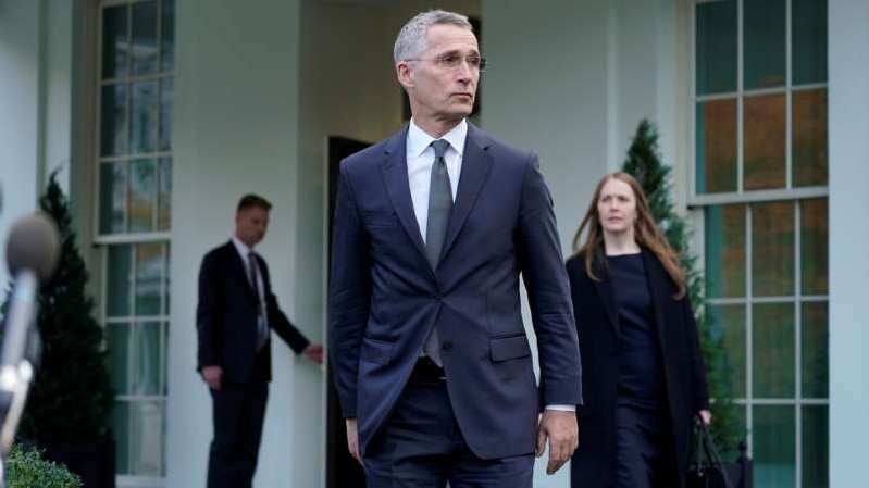 Jens Stoltenberg wearing a suit and tie standing in front of a building: NATO Secretary General Jens Stoltenberg walks out to speak to reporters after meeting with President Donald Trump at the White House.