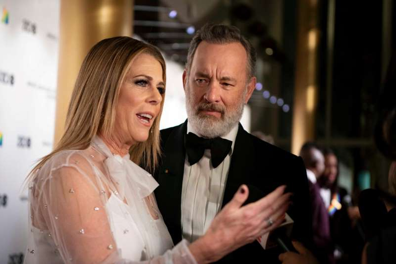 Tom Hanks, Rita Wilson are posing for a picture: Tom Hanks and Rita Wilson attend the Kennedy Center Honors in Washington DC.