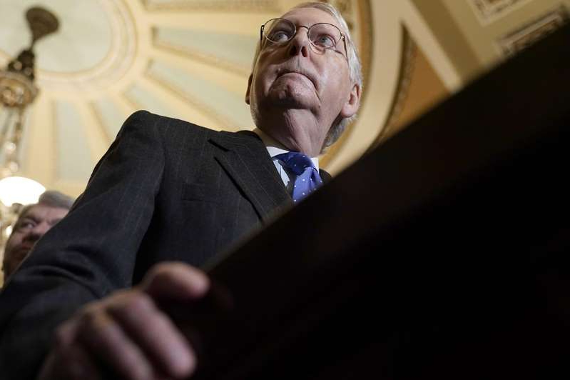 a man wearing a suit and tie: Senate Majority Leader Mitch McConnell.