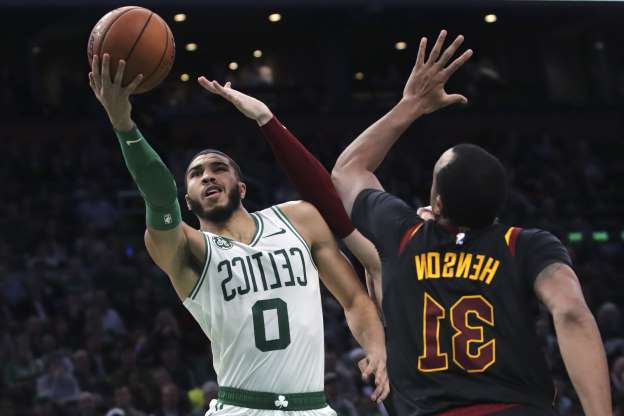 Boston Celtics forward Jayson Tatum (0) drives to the basket against Cleveland Cavaliers forward John Henson (31) during the second half of an NBA basketball game in Boston, Monday, Dec. 9, 2019. The Celtics won 110-88. (AP Photo/Charles Krupa)