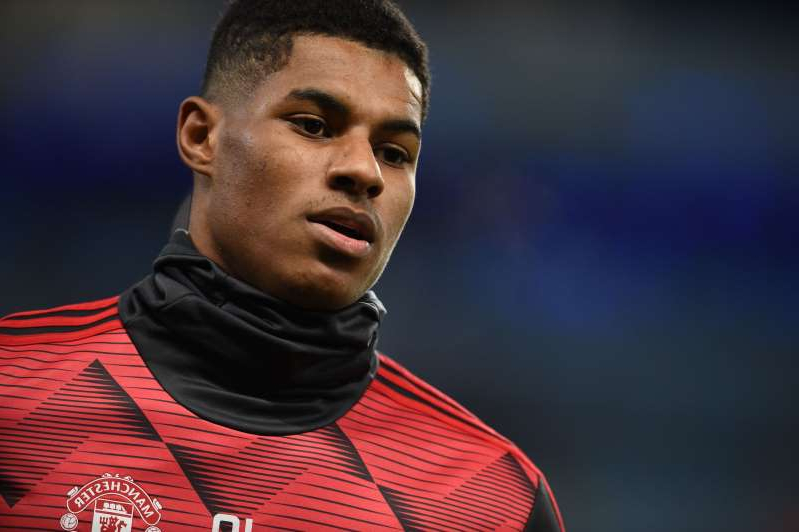 Manchester United's English striker Marcus Rashford warms up for the English Premier League football match between Manchester City and Manchester United at the Etihad Stadium in Manchester, north west England, on December 7, 2019. (Photo by Oli SCARFF / AFP) / RESTRICTED TO EDITORIAL USE. No use with unauthorized audio, video, data, fixture lists, club/league logos or 'live' services. Online in-match use limited to 120 images. An additional 40 images may be used in extra time. No video emulation. Social media in-match use limited to 120 images. An additional 40 images may be used in extra time. No use in betting publications, games or single club/league/player publications. /  (Photo by OLI SCARFF/AFP via Getty Images)
