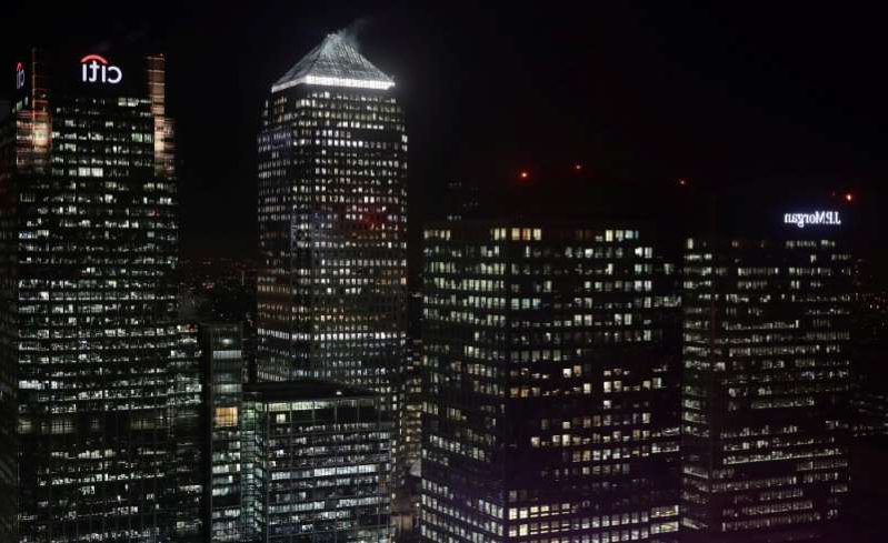 a city at night: Citibank and J P Morgan buildings are seen in the financial district of Canary Wharf