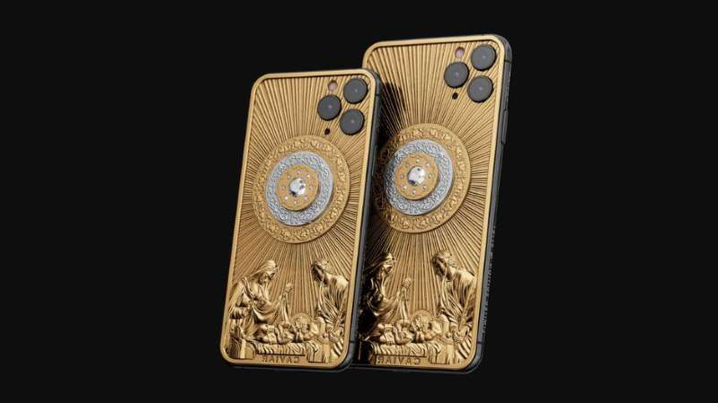 a clock that is on display: Celebrate Christmas with a gold and diamond iPhone 11 from Caviar. Caviar