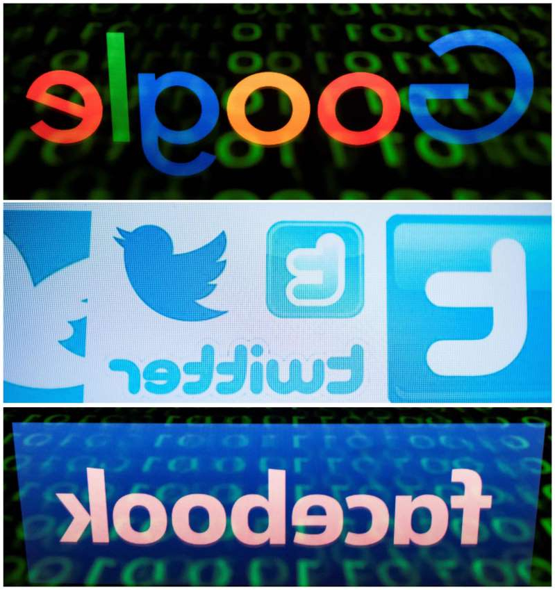 a close up of a sign: Google, Twitter, Facebook logos. What happens to your social media accounts after you die?