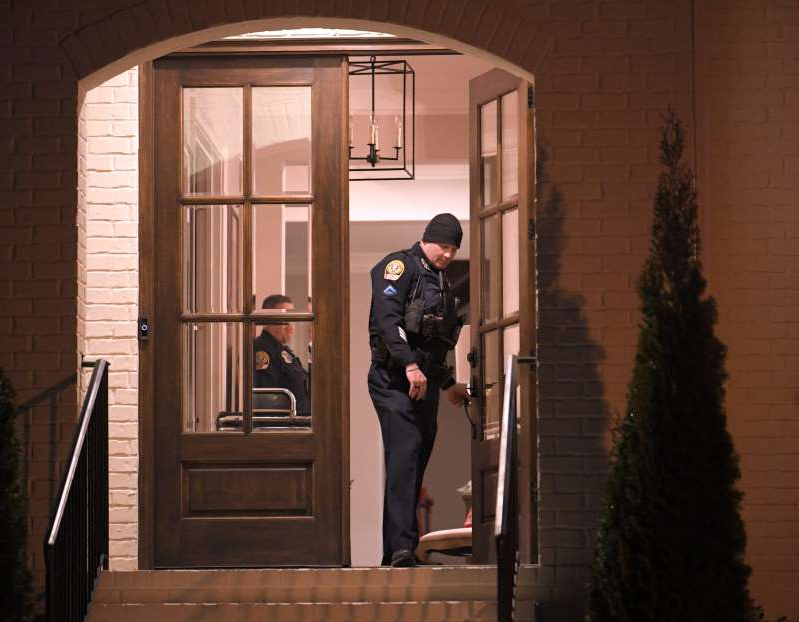 a man standing in front of a door: Franklin police investigate after a mother and son were found dead in their home Tuesday, Dec. 10 , 2019. The pair were found in a home in the Hurstbourne Park neighborhood off Murfreesboro Road, police indicated.