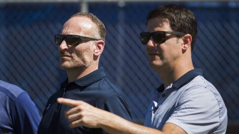 a man wearing sunglasses: Toronto Blue Jays general manager Ross Atkins, left, talks with Blue Jays President Mark Shapiro, right, during baseball spring training in Dunedin, Fla., on Friday, February 24, 2017. (Nathan Denette/CP)