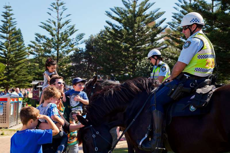 Coogee, Australia - September 28,2014: Mounted police meet the public at a beach soccer tournament between police and international students.