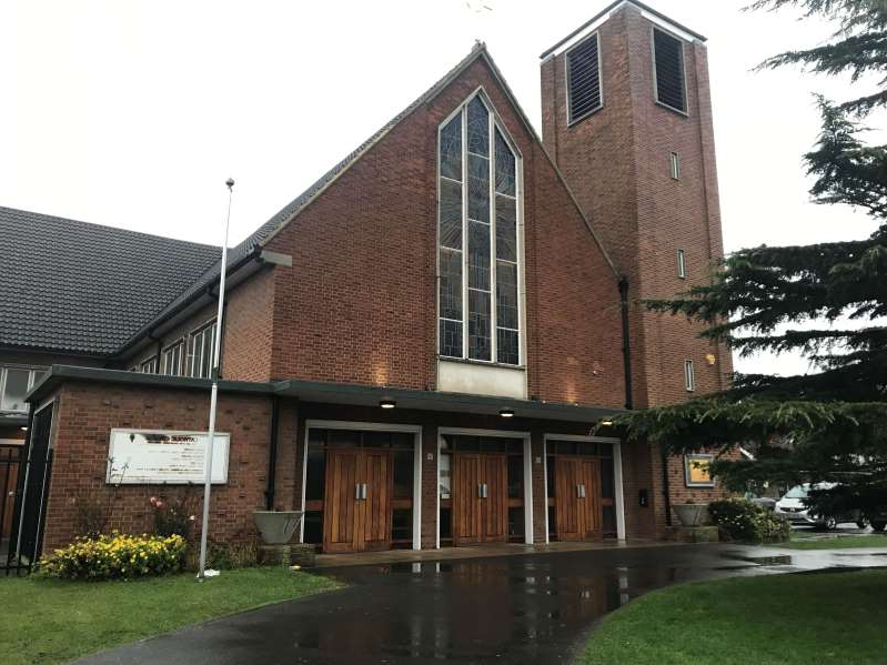 a large brick building with grass in front of a house: Our Lady of the Annunciation Church on Bingham Road, Croydon where a young boy suffered serious burns during a school Christmas carol event on Wednesday. (PA)