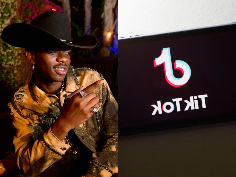 a person wearing a hat talking on a cell phone: Lil Nas X.