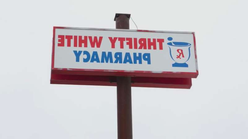 a red and white sign