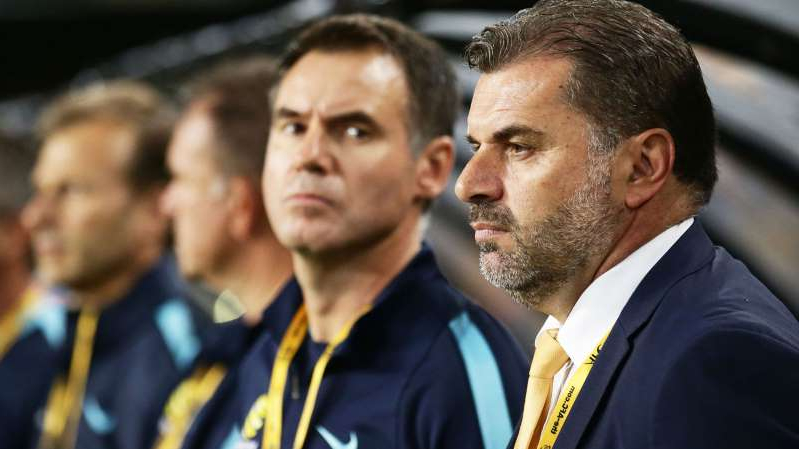 Ange Postecoglou wearing a suit and tie