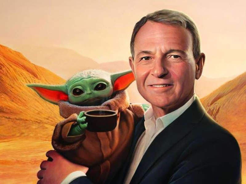 Bob Iger smiling for the camera: It was love at first sight for Disney CEO Bob Iger and Baby Yoda. Tim O'Brien/Time