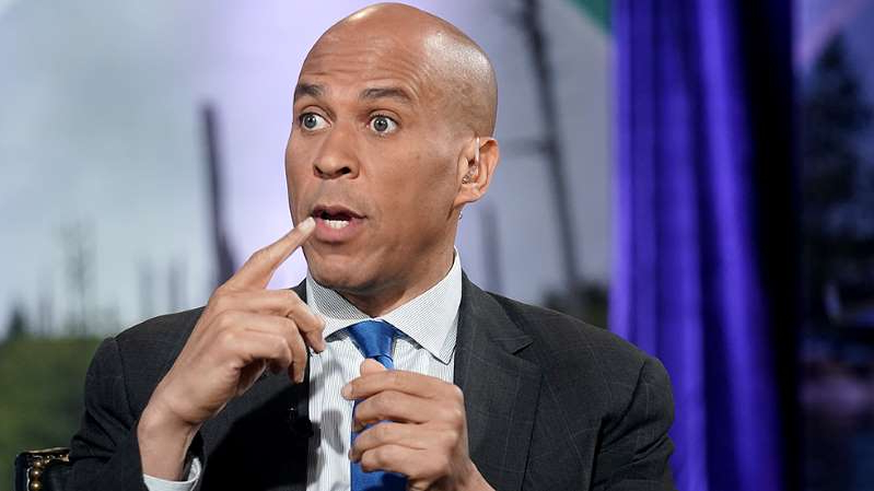 Cory Booker wearing a suit and tie: Booker says he will not make December debate stage