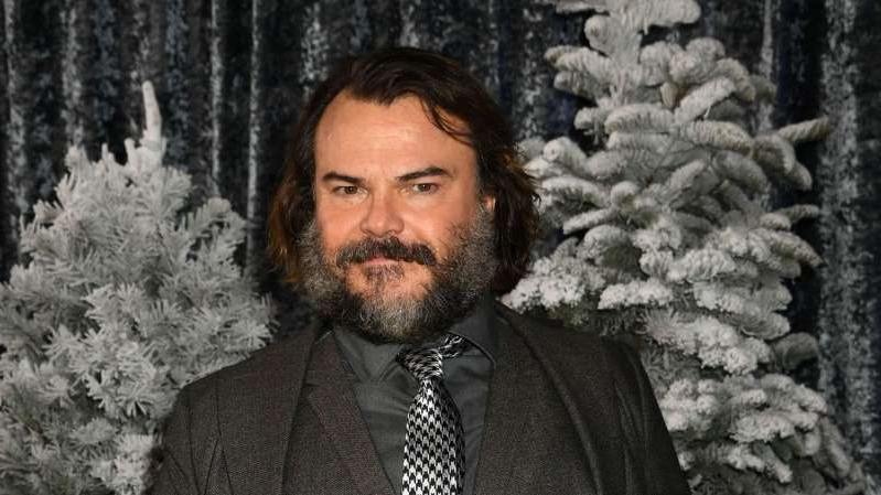Jack Black wearing a suit and tie
