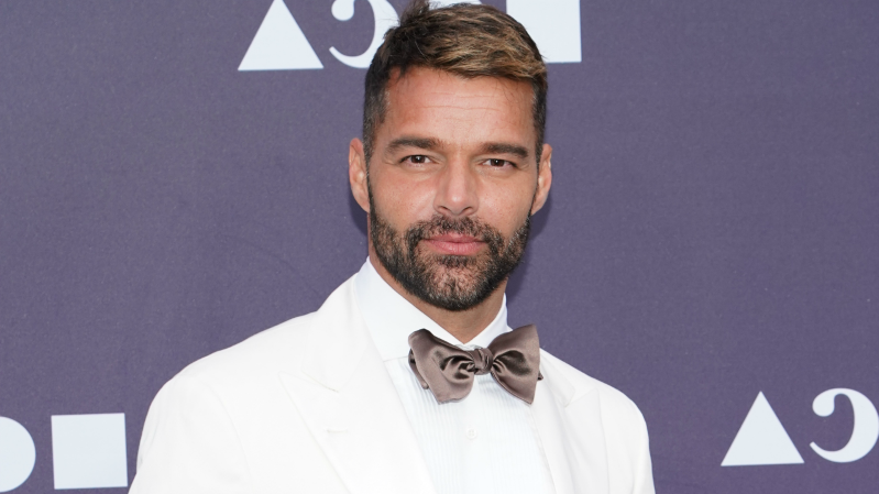 Ricky Martin wearing a suit and tie