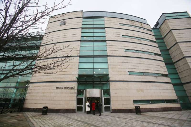 a bench in front of a building: The trial may be heard at Belfast's Laganside Courts