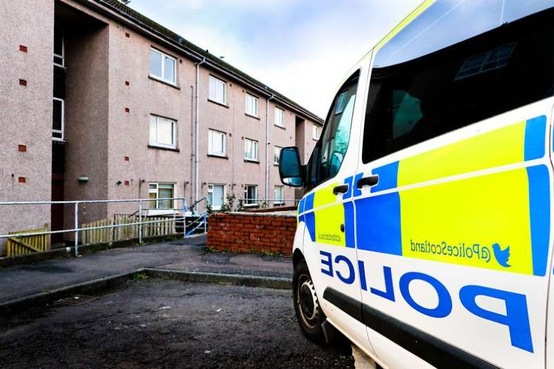 a bus parked on the side of a building: Maybole's Whitehall Court was sealed off following the attack