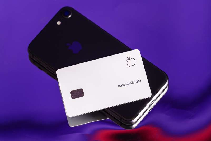 a close up of a device: The Apple Card pictured with an iPhone