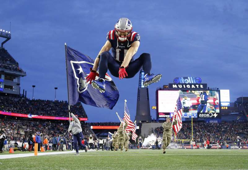 a group of people jumping in the air: By leaps and bounds, Julian Edelman is the Patriots' leading receiver with 90 catches for 1,010 yards.
