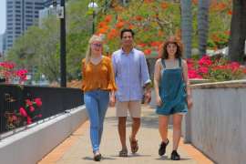a person walking down a street: Going forward: Alithia Bowman (Yeronga SHS), Joseph Rangiah (Brisbane SHS) and Megan Gardner (Kenmore SHS) will be among the thousands of Queensland students receiving their OP scores on Saturday.