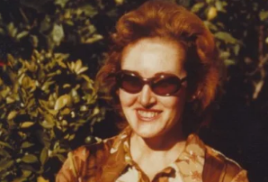 a woman wearing glasses and smiling at the camera: Tatiana Sokoloff was found strangled and in a pool of her blood on her Haberfield balcony in 1986.