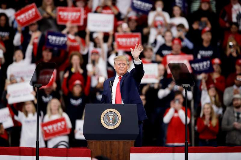 Donald Trump standing in front of a crowd: President Donald Trump campaigns  in Hershey, Pennsylvania, on Dec. 10, 2019.