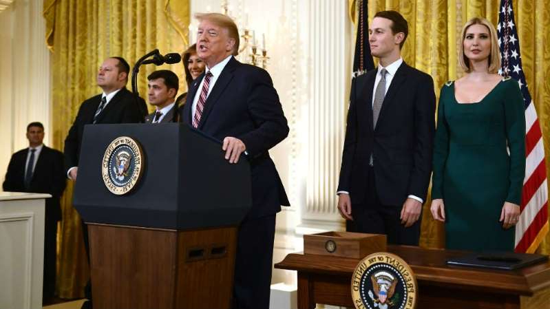 Ivanka Trump, Jared Kushner, Donald Trump standing next to a person in a suit and tie: President Trump has also been accused of making anti-Semitic remarks. His daughter Ivanka and son-in-law Jared Kushner are Jewish.